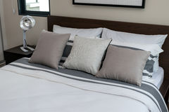 Bed and pillows with white lamp Stock Image