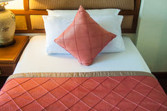 Bed in pink bed linen Royalty Free Stock Photos