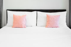 Bed and pink pillows Royalty Free Stock Image