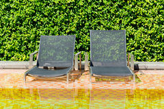 Bed by the pool Royalty Free Stock Photography