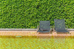 Bed by the pool Royalty Free Stock Image