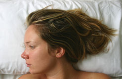 Bed Portrait. Blonde with head on the pillow Stock Photography