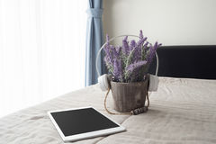 The bed with purple lavender flower virtual listening music  on flower pot Royalty Free Stock Images