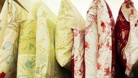 Bed quilts hanging down. Colorful bed quilts hanging down Stock Photo