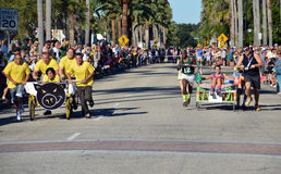 Bed Racing in Venice FL. VENICE, FL - OCTOBER 18: Competitors pushing a bed in competition during the 11th Annual Venice Sun Fiesta bed race on October 18, 2014 royalty free stock photography