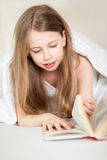 Bed read girl stock image