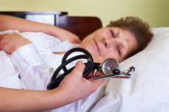 Bed ridden elderly woman Stock Photography