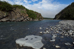 The bed of the river in the rocky shores. Stock Images