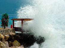 Bed on the rock. Splashed with wave Royalty Free Stock Photo