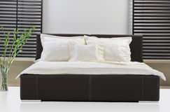 Bed room. A view of a modern bed room Stock Photos