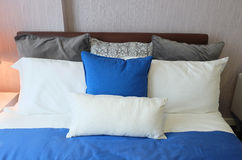 Bed in room with blue pillows Royalty Free Stock Photography