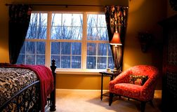 Bed room interior. Warm bed room interiors showing bed and sofa Royalty Free Stock Photos