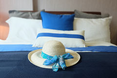 Bed in room with pillows and hat Royalty Free Stock Photos