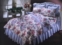 Bed room set with bedding Royalty Free Stock Photos