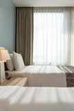 Bed room with white pillows , sheets and curtain Royalty Free Stock Photos