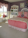Bed Room Young Girls. Cute young girls bed room with white pink and purple colors white desk with hutch Stock Images