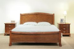 Bed Set. Heavy wood queen-size bed set with headboard and bedside table drawers
