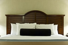 Bed settings. Comfortable bed settings with fluffy pillows and fresh linens Stock Photography