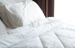 Bed sheet and pillow messed up Stock Image