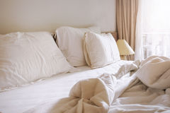Bed sheet pillows and blanket messed up in bedroom Royalty Free Stock Image