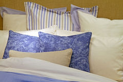 Bed sheets. Cotton bed sheets with big pile of pillows Royalty Free Stock Images