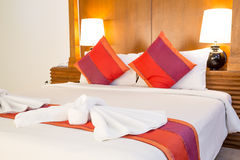Bed sheets and red pillows. Are orderly Stock Photography