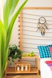 Bed shelf in ethnic bedroom Royalty Free Stock Photos