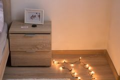bed side desk picture frame and floor with lights royalty free stock photography
