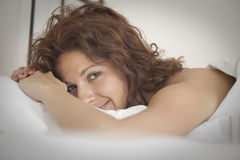 In the bed with smile Royalty Free Stock Image
