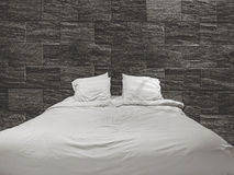 Bed and stone wall Royalty Free Stock Image