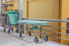 Bed stretcher or patient bed in the hospital corridor. Green Bed stretcher or patient bed in the hospital corridor stock photography