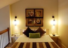 Bed in a stylish duplex room in luxury hotel. Royalty Free Stock Photo