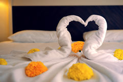 Bed Suite decorated with flowers. And towels Royalty Free Stock Photography