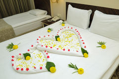 Bed Suite decorated with flowers. And towels Stock Photo