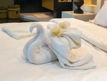 Bed Suite decorated with flowers and swan towel Royalty Free Stock Image