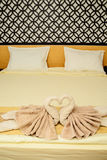 Bed suite decorated with  towels Royalty Free Stock Images