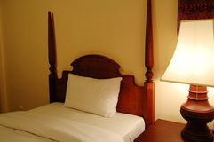 Bed and table lamp Stock Photography