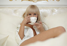 In bed with tea Stock Photo