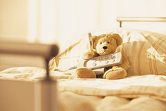 Bed Teddy bear hospital remote control Royalty Free Stock Photo