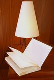 Bed time reading lamp. With book stock photos