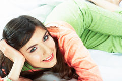 Bed time smiling  woman portrait. Royalty Free Stock Photography
