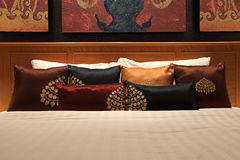 Bed in traditional Thai setting Royalty Free Stock Photography