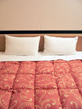Bed with two pillows. Served bed with two pillows in hotel room Royalty Free Stock Image