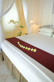 Bed under bed curtains Royalty Free Stock Photo