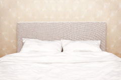 Bed at a wall Stock Image