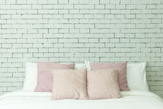 The bed on white bricks wall background Royalty Free Stock Image