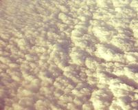 Bed of White Clouds in Sky captured from Air. This is a photograph of a bed of white clouds spread in the sky, captured while traveling in air Stock Photo
