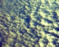 Bed of White Clouds in Sky captured from Air. This is a photograph of a bed of white clouds spread in the sky, captured while traveling in air Royalty Free Stock Photos
