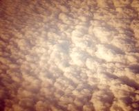 Bed of White Clouds in Sky captured from Air with Sepia Effect Stock Images