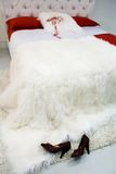 Bed with a white coverlet Royalty Free Stock Photo